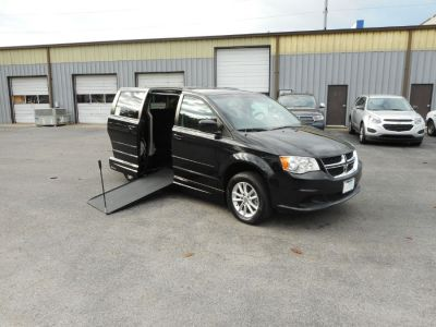 Black Dodge Grand Caravan with Side Entry Manual In Floor ramp