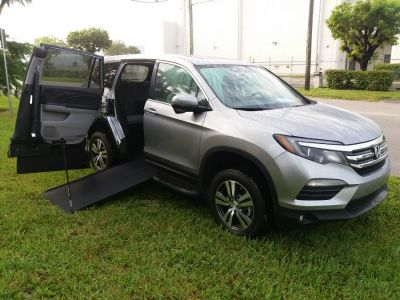 Silver Honda Pilot with Side Entry Manual In Floor ramp
