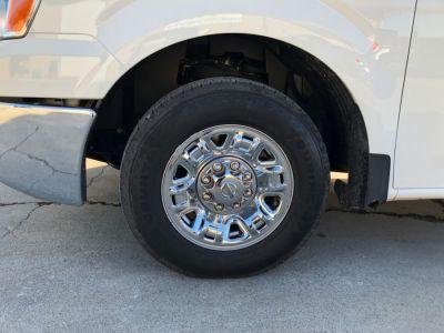 WHITE Nissan NV Passenger image number 17