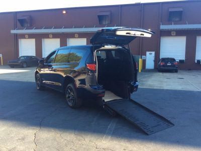 Blue Chrysler Pacifica with Rear Entry Manual Fold Out ramp