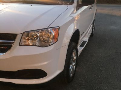 White Dodge Grand Caravan with Side Entry Manual In Floor ramp