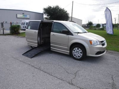 Brown Dodge Grand Caravan with Side Entry Automatic Fold Out ramp