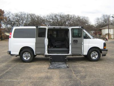 White GMC Savana Passenger with Side Entry Automatic  ramp