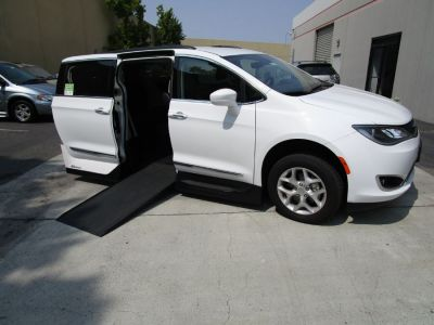 White Chrysler Pacifica with Side Entry Automatic In Floor ramp