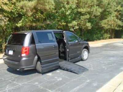 Gray Dodge Grand Caravan with Side Entry Automatic Fold Out ramp