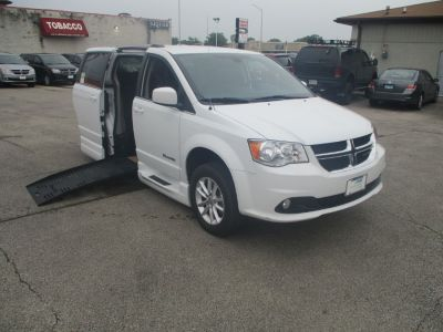 White Dodge Grand Caravan with Side Entry Automatic Fold Out ramp