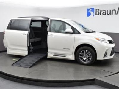 White Toyota Sienna with Side Entry Automatic Fold Out ramp