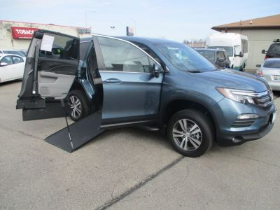 Blue Honda Pilot with Side Entry Manual In Floor ramp
