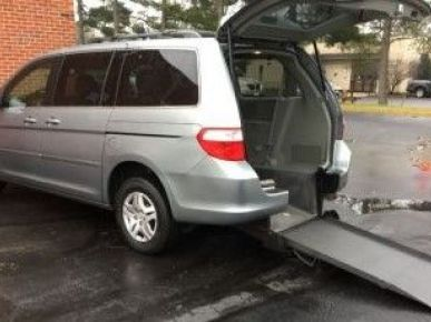 Silver Honda Odyssey with Rear Entry Manual Fold Out ramp